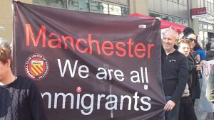 banner at demonstration in Manchester